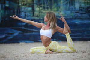How does one attain moksha through karma yoga? 19