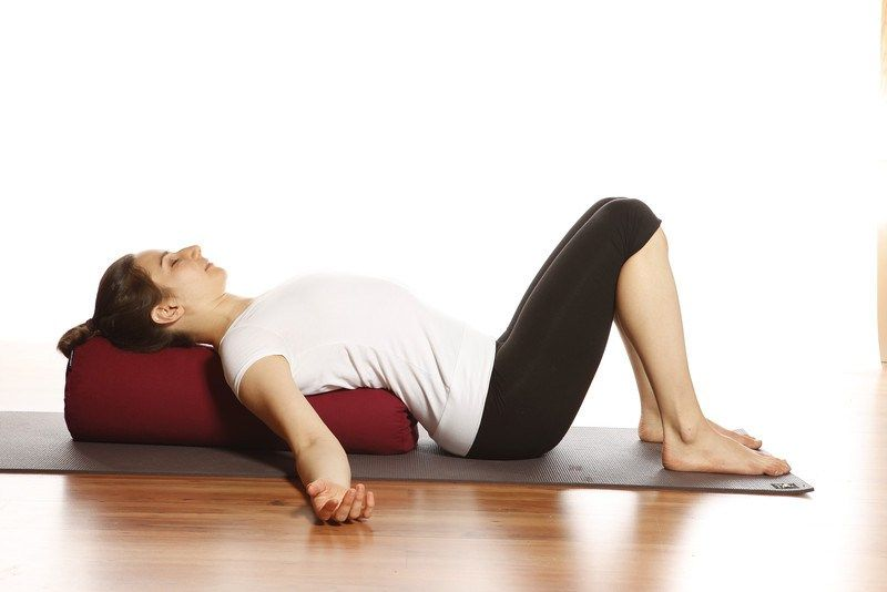 bolster yoga pose